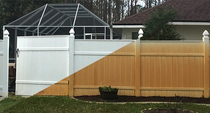 rust removal of a white picket fence