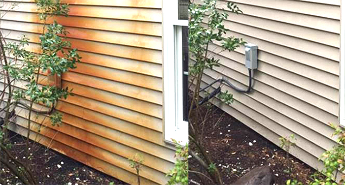 Rus removal on the siding of a house